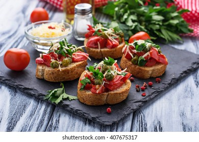 Traditional Italian antipasti bruschetta with pepper, peas and cheese