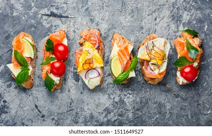 Traditional italian bruschetta.Open sandwich with salmon and vegetables