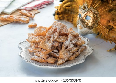 Traditional Italian carnival fritters dusted with icing sugar - frappe or chiacchiere
