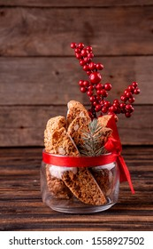 Traditional italian Christmas New Year dry cookies biscuits biscotti cantuccini in glass bowl on wooden background. Biscotti di Prato.