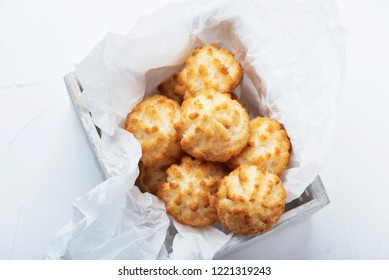 Traditional italian coconut cookies on the wooden table, selective focus