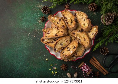 Traditional italian cookies biscotti with dried cranberry and nuts, top view, copy space