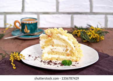 Traditional Italian dessert, homemade Mimosa cake. Biscuit cake with custard, whipped cream and pineapple.