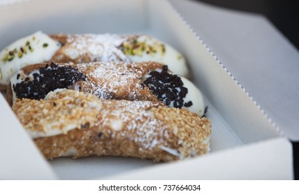 Traditional Italian dessert - Sicilian cannoli. Crispy fried pastry tubes filled with luscious ricotta cheese cream