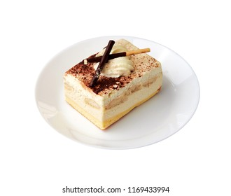 Traditional italian dessert tiramisu/ tiramisu cake with cream mascarpone and cacao powder on a white plate. White background. Close up. Isolated
