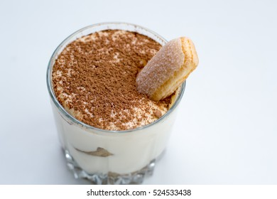 Traditional Italian dessert tiramisu decorated with cocoa. Copy space, top view
