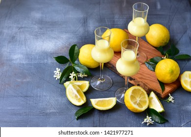 traditional Italian digestif:  liqueur Limoncello with lemons and cream, Italian food , Italy