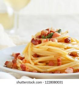 Traditional italian dish spaghetti carbonara with bacon, egg and cheese