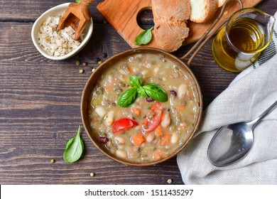 """Traditional Italian dish """"zuppa Toscana"""" from Tuscany ( Florence ) soup with different types of beans, carrots and vegetables. Vegan recipe. autumn winter food menu, food Italy.  Selective focus"""