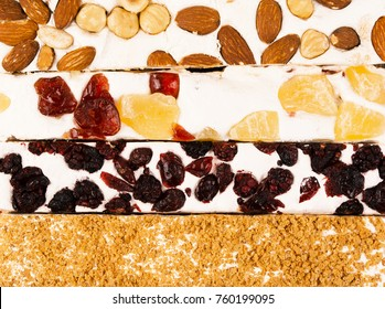 Traditional italian festive torrone or nougat with nuts close up.