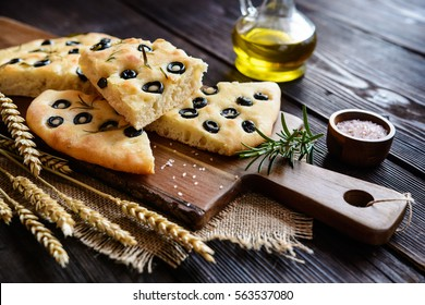 Traditional Italian Focaccia with black olives and rosemary