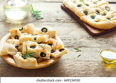 Traditional Italian Focaccia with black olives and rosemary - homemade flat bread focaccia