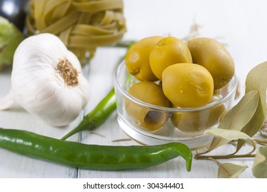 traditional italian food ingredients on white wood table
