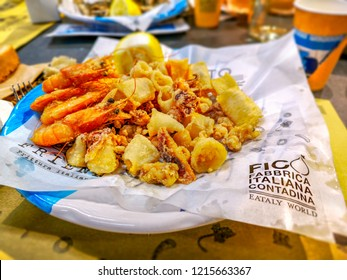 traditional italian Fritto Misto is a Fried fish fry dish served in one of the restaurants of italian food theme park called FIco Eataly World in Bologna, Italy, 20 Oct 2018