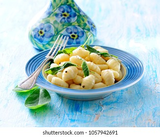 Traditional italian gnocchi potato dumplings with sage and butter sauce.