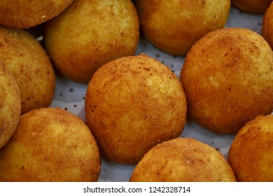 Traditional Italian kitchen meal and street food from Sicily - arancini - for sale in Christmas stalls everywhere in Italy