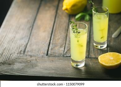 Traditional italian lemon liqueur limoncello and fresh citrus lemon. Alcoholic beverage.