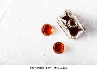 Traditional italian liqueur amaretto, top view with copy space for text