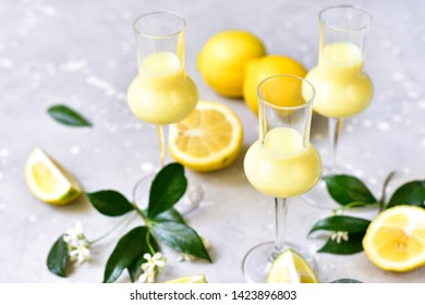 traditional Italian liqueur Limoncello with lemons and cream, Italian food , Italy, Sicilian lemons
