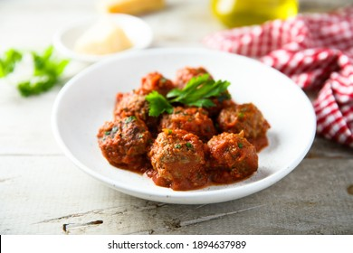 Traditional Italian meatballs with tomato sauce and parsley