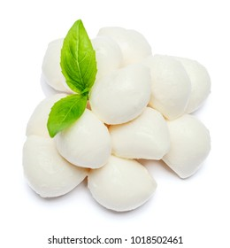 Traditional Italian Mozzarella cheese and basil on white background
