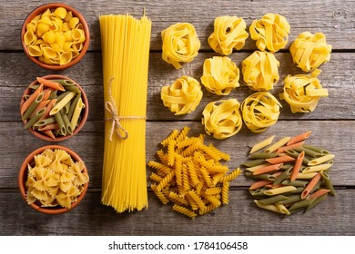 Traditional italian nutrion background . Assortment of pasta on wood