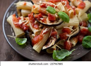 Traditional italian pasta alla Norma, horizontal shot, close-up