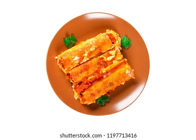 Traditional Italian pasta cannelloni. Baked tubes stuffed with minced meat and bechamel sauce on a white background. Cannelloni pasta isolated on white background. Top view. Cannelloni pasta isolate.