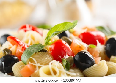 traditional Italian pasta Pipe Rigate with tomatoes, olives and Basil