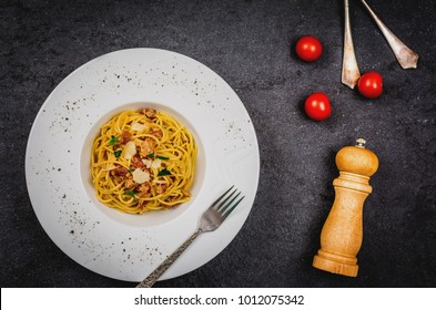 Traditional italian pasta spaghetti carbonara with bacon and cheese parmesan top view