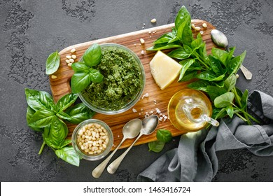 Traditional italian pesto alla genovese with fresh basil leaves, pine nuts, olive oil, garlic and parmesan cheese
