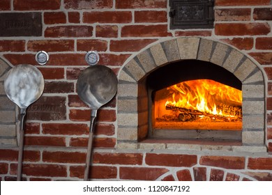 Traditional italian Pizza oven, burning wood and flames in fireplace
