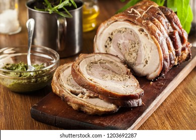 Traditional italian porchetta. Rolled pork belly stuffed with mincemeat and herbs.