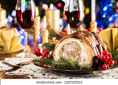 Traditional italian porchetta. Rolled pork belly with baked potatoes on festive table