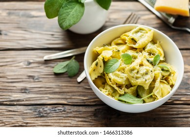 Traditional italian raviolli with sage and ricotta, rstic style and selective focus