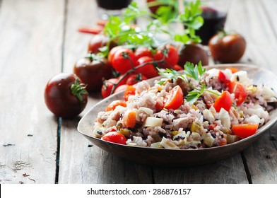 Traditional italian rice salad with tuna and vegetables, selective focus