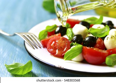 "Traditional italian salad ""Caprese"" with black olives."