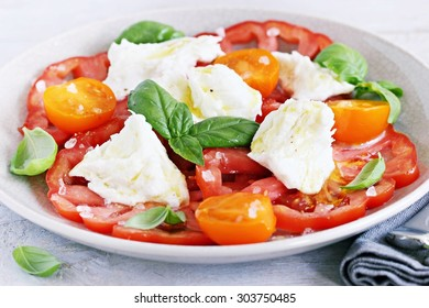 Traditional Italian salad with tomatoes,mozzarella and basil. Selective focus