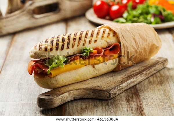 Traditional Italian sandwich with ham and cheese served warm.