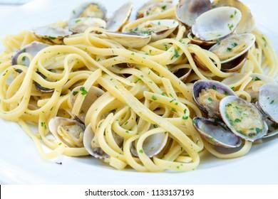 Traditional Italian seafood, spaghetti vongole made with seashells and linguini pasta