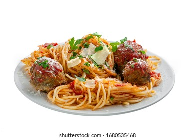 Traditional Italian spaghetti with meatballs and parmesan in tomato sauce on a white plate. American family meal isolated on white background.