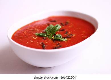 Traditional italian tomato soup with basil