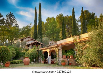 Traditional italian villa with yard and garden, Tuscany, Italy