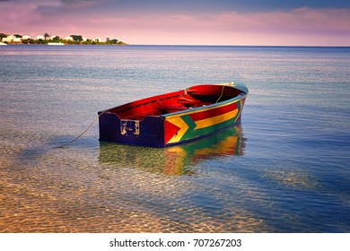 Traditional Jamaican fishing boat floating out from the beach on Bloody Bay, Jamaica.