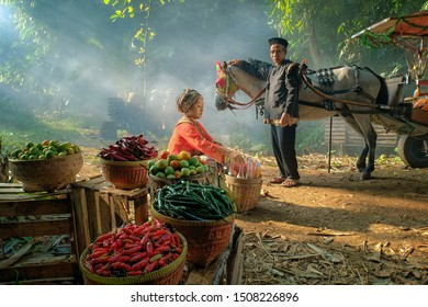 Traditional jamu seller at Bogor west Java Indonesia. Jamu is a traditional medicine from Indonesia. It is predominantly a herbal medicine made from natural materials. 07 07 2019