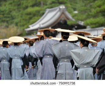 Traditional Japanese costumes for men includin amazing hata on a parade in Kyoto Japan