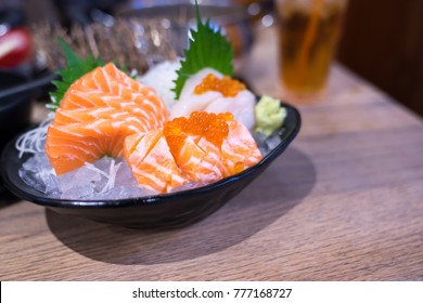 Traditional Japanese cuisine.Various kinds Sushi Set sashimi and sushi rolls.  Fresh made Sushi set with salmon, prawns, wasabi and ginger in restaurant.Selective focus