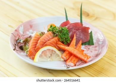 Traditional japanese food, Mix fresh fish sashimi on wooden table