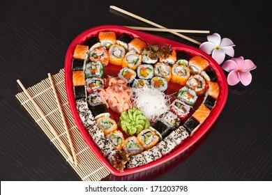 Traditional Japanese food Sushi. Closeup japanese sushi on a bamboo napkin. Sushi collection in valentines day.