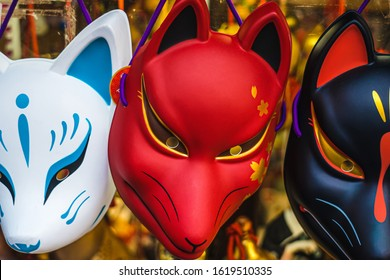 Traditional japanese fox masks called kitsune. In Japanese culture, Fox has contradictory behavior. It can be benevolent (good) or malevolent (evil) depending on the situation. Kyoto, Japan